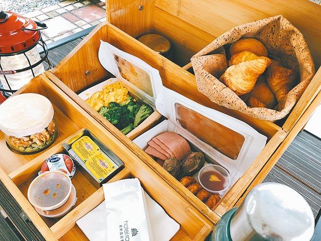 早餐彷彿《愛麗絲夢遊仙境》戶外溫馨的餐會,盒裡承裝多款美味輕食。(黃采薇攝)