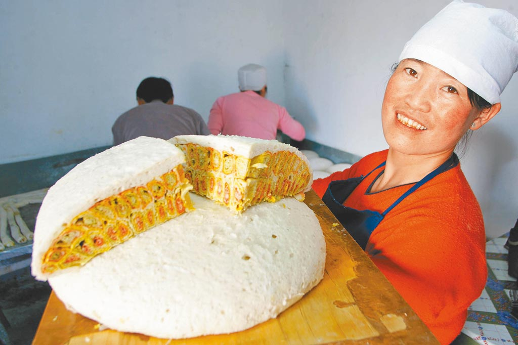蒸餅。(新華社資料照片)