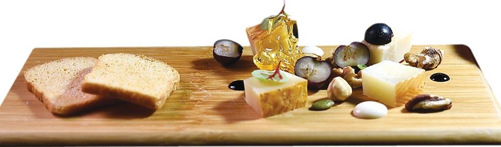 〈起司盤〉的名字叫「一年」,共用了分別經過3、6、9與12個月熟成的西班牙曼徹格起司(Manchego Cheese)共構,食客可比較不同「年紀」西班牙經典乳酪的風味。圖/姚舜