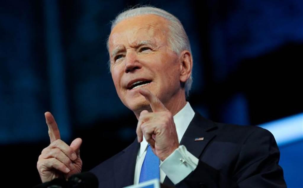拜登今天才由選舉人團正式確認為美國總統當選人,渣打報告竟預測他明年辭職可能成為重大風險事件。(路透)