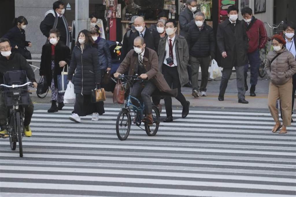 疫情恶化,日本今年12月28日至明年1月11日「去旅行」国内振兴旅游方案全面喊卡。图为东京街头。(美联社)(photo:ChinaTimes)