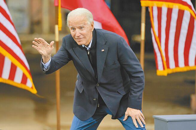 美國總統當選人拜登15日在喬治亞州首府亞特蘭大為民主黨參議員候選人拉票。(美聯社)