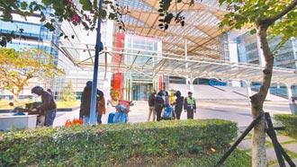广达集团员工确诊 台股扫到颱风尾