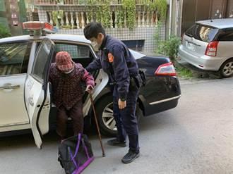 老婦癱坐分隔島 警照料助返家