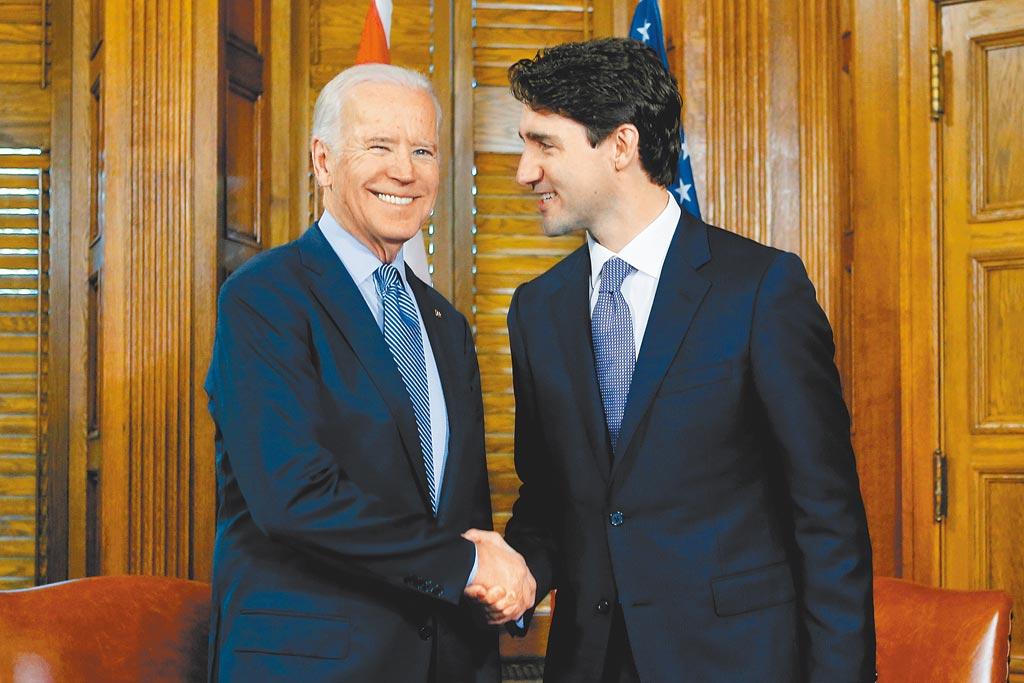 加拿大總理杜魯道(右)20日晚發表聲明說,加方歡迎拜登在應對氣候變化方面的承諾,但對其撤銷「基石」項目感到失望。(路透)