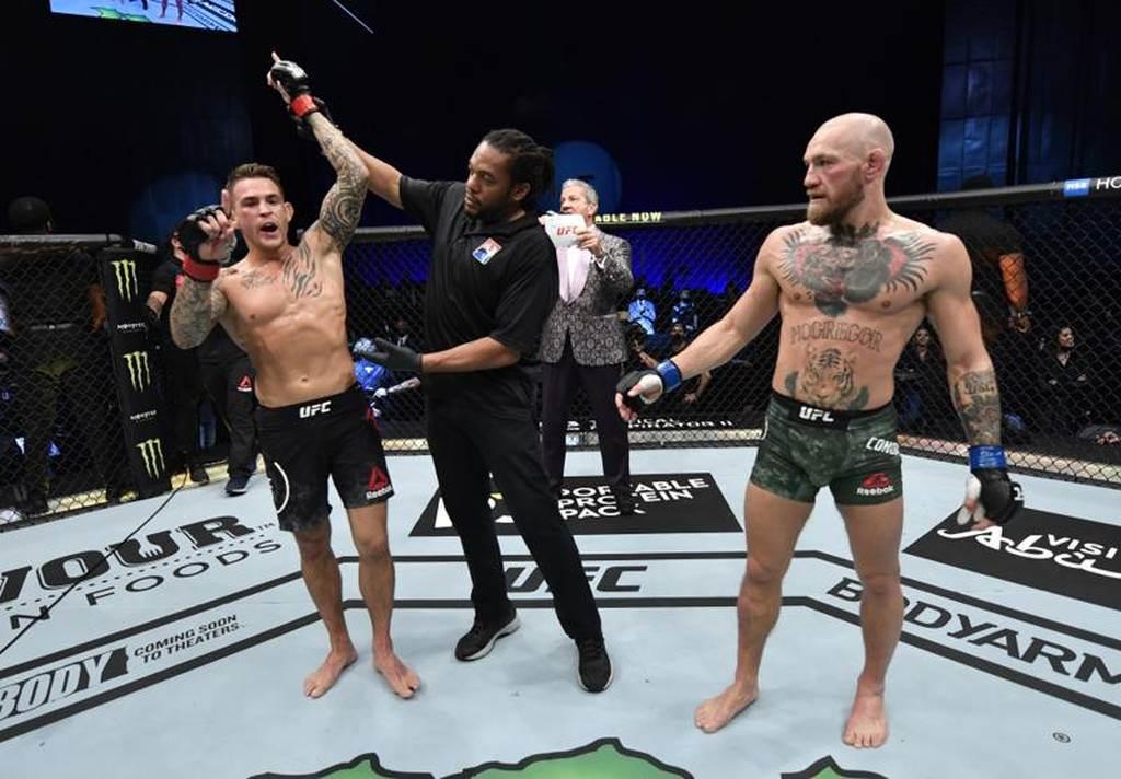 UFC拳手麥葛雷格(右)意外被波瑞耶打敗。(路透)