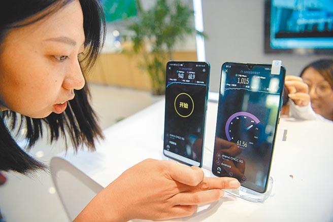 受陸手機大廠加持,聯發科今年5G手機晶片出貨拚倍增。圖/中新社