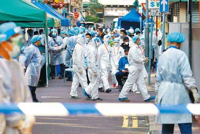 港府23日凌晨4時宣布對九龍佐敦部分區域進行封區,要求封鎖範圍內所有居民48小時內接受核酸檢測。(中新社)