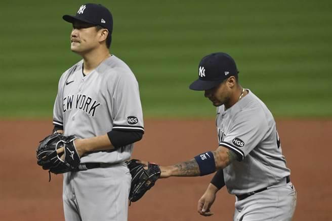 田中將大(左)離開大聯盟返回日本職棒。(美聯社資料照)