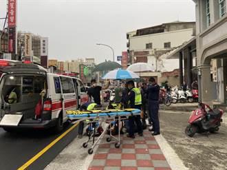 新竹女子車禍倒地爬不起 暖警幫撐傘擋風雨