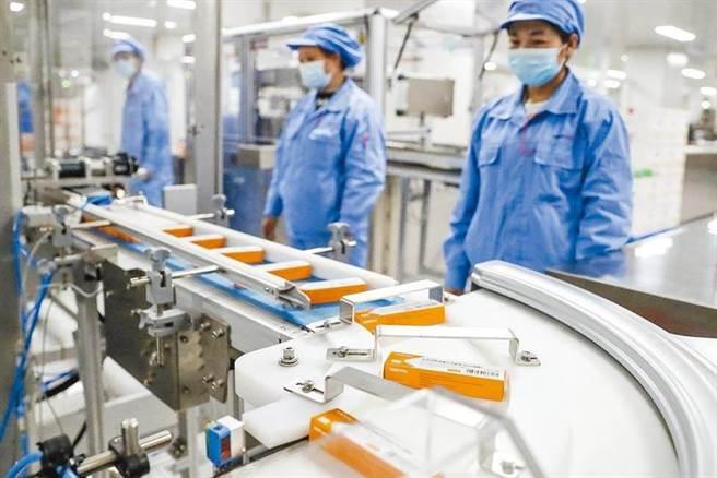 大陸再有2款國產新冠疫苗同時獲附條件上市,迄今已上市4款新冠疫苗。(新華社)