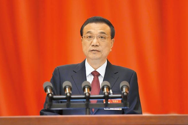 第十三屆全國人民代表大會第四次會議在北京人民大會堂開幕。中國國務院總理李克強作政府工作報告。(中新社)
