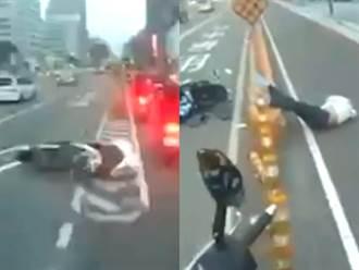 驚悚片曝光 機車內切倒地狂滑 騎士雙腳高掛防撞桿昏迷