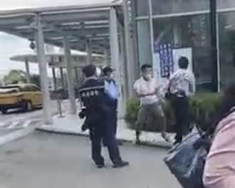 淡水男醫院外對警衛揮拳引熱議  4名警衛上前聯合壓制