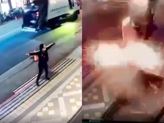 影片曝光 炸彈客高舉炸彈丟酒店 下秒火光冒出碎片四濺