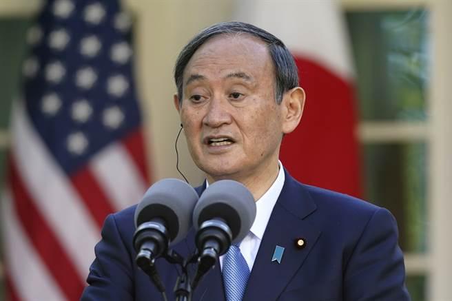 菅義偉表示,期待通過當事雙方的直接對話和平解決臺灣問題是日本一貫立場,這也進一步明確為日美的共同立場。(圖/美聯社)