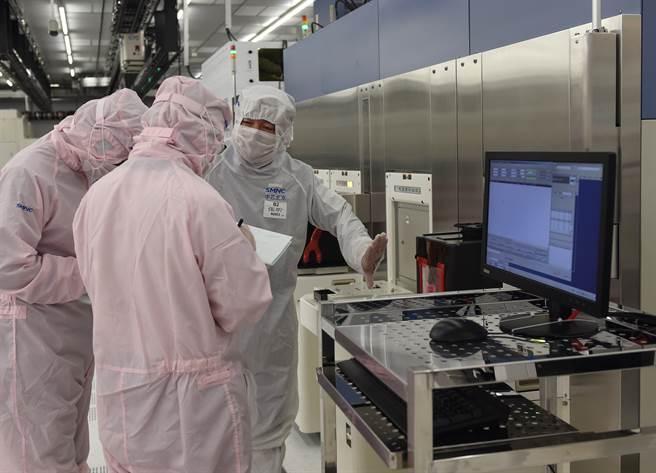 大陸清華大學宣布成立集成電路學院,為資訊科技工業關鍵領域產業培養人才,破解當前晶片技術遭「卡脖子」難題。(圖/新華社)