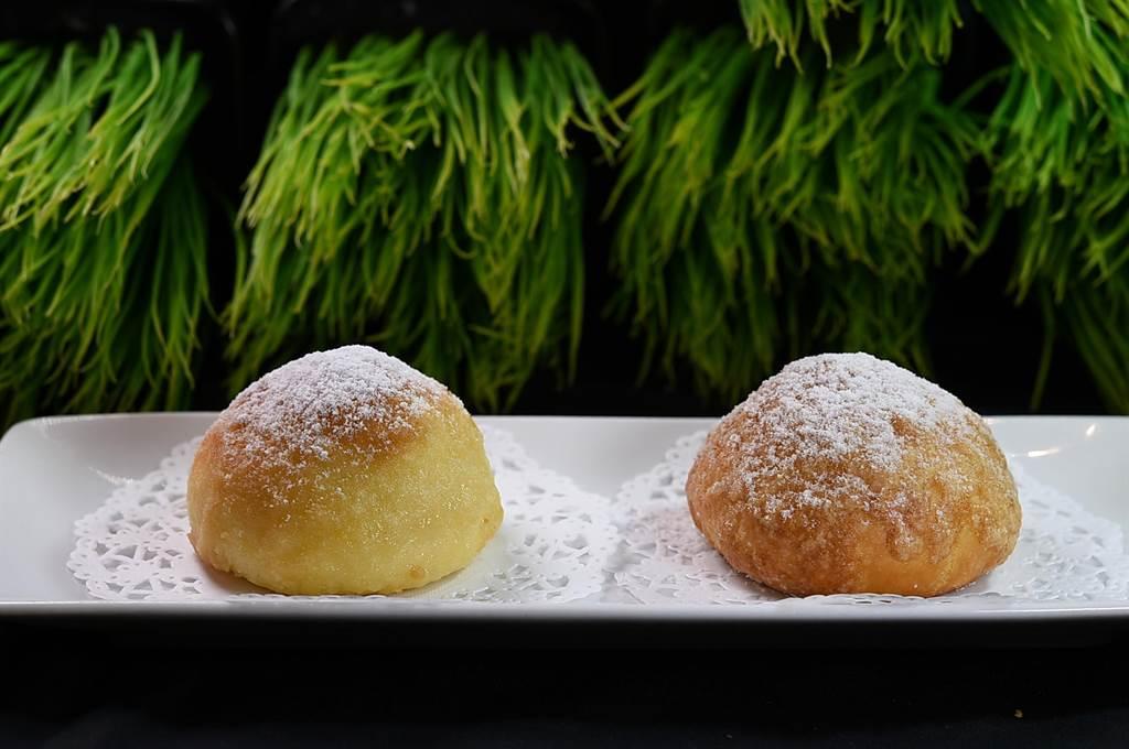 〈菠蘿叉燒包〉表層灑了糖霜粉,所以又稱〈雪山叉燒包〉。(圖/姚舜)