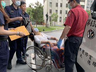 女子街頭辱警 士林地檢開庭頭暈送醫