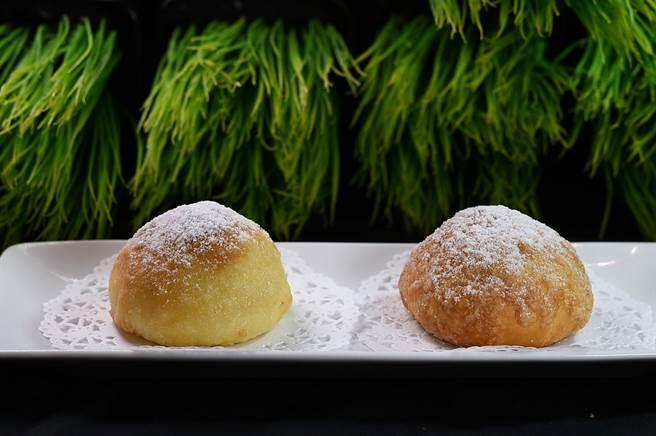 〈菠萝叉烧包〉表层洒了糖霜粉,所以又称〈雪山叉烧包〉。(图/姚舜)