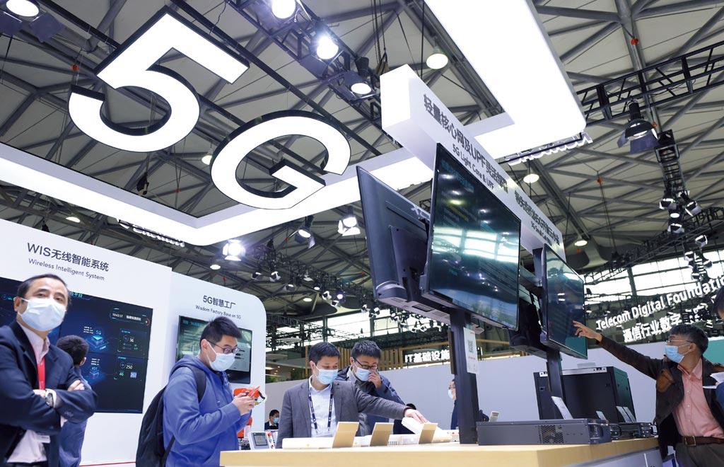 未來大陸將以「數位經濟」為槓桿,在5G網路與應用、人工智慧、工業互聯網、物聯網等新興產業領域重訂標準。圖/新華社