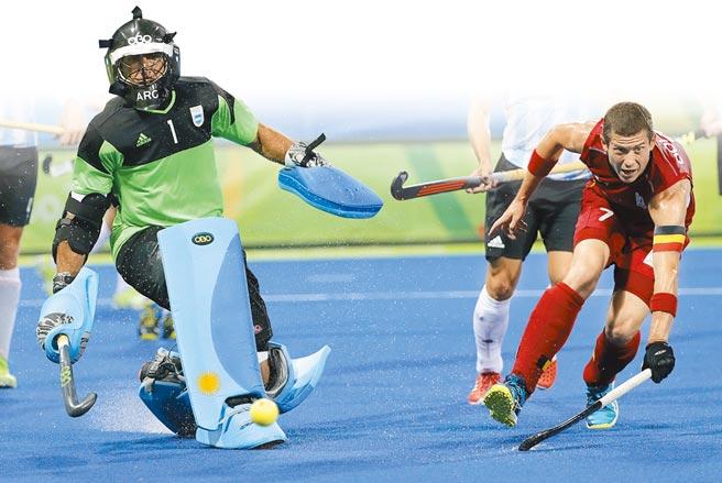 比利時名將多赫曼(右)希望討回上屆奧運決賽敗給阿根廷的遺憾。(美聯社)