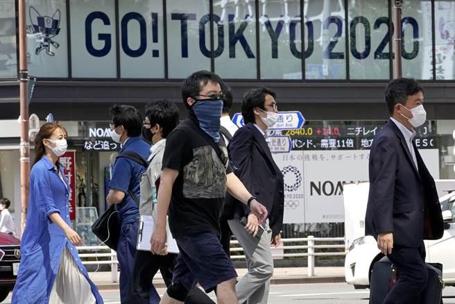 東京疫情持續升溫,若「防止蔓延等重點措施」無法如期在7月11日解除,恐為東京奧運開放觀眾進場增添變數。(圖/美聯社)
