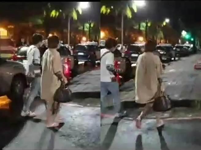 崔女身穿同一件駝色外套、腳踩拖鞋、手提名牌包下車後步行至警局;她的推特也遭網友搜出不少性感裸露照。(民眾提供)