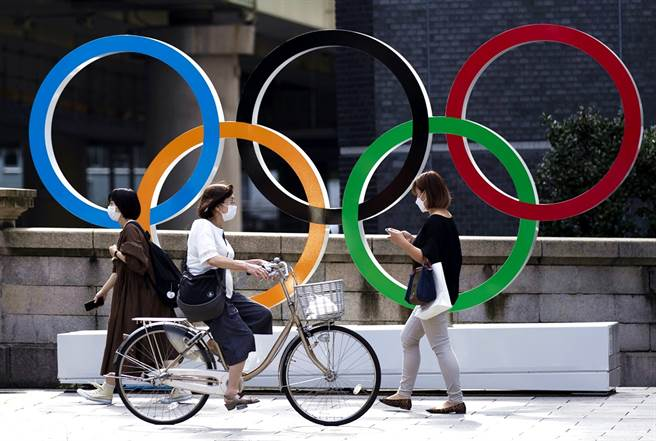 新冠病例激增,日本東京奧運組織委員會秘書長武藤敏郎20日受訪時,並未排除在最後一刻取消東奧的可能性。(資料照/美聯社)