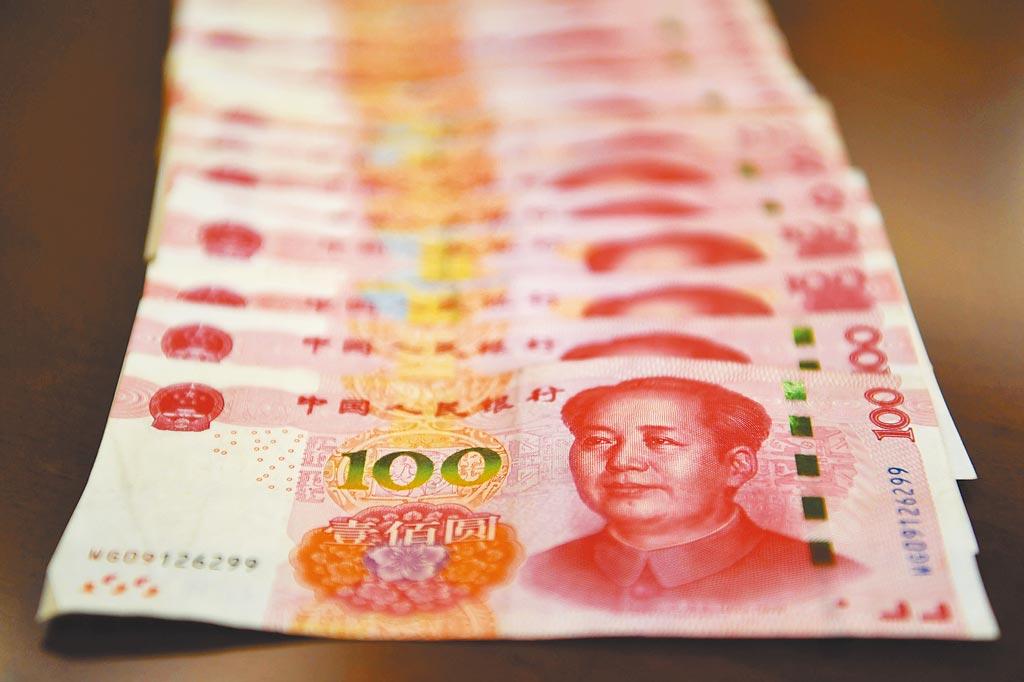 中國人民大學國際貨幣研究所24日發布的《人民幣國際化報告2021》指出,人民幣國際化指數(RII)到去年第4季為5.02,年增率達54.2%,創下歷史新高。(中新社)