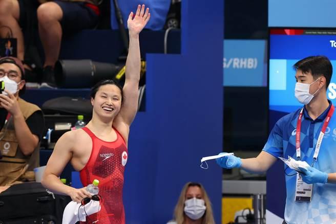加拿大游泳女將瑪格麗特26日拿下東奧女子100公尺蝶式金牌。(路透)