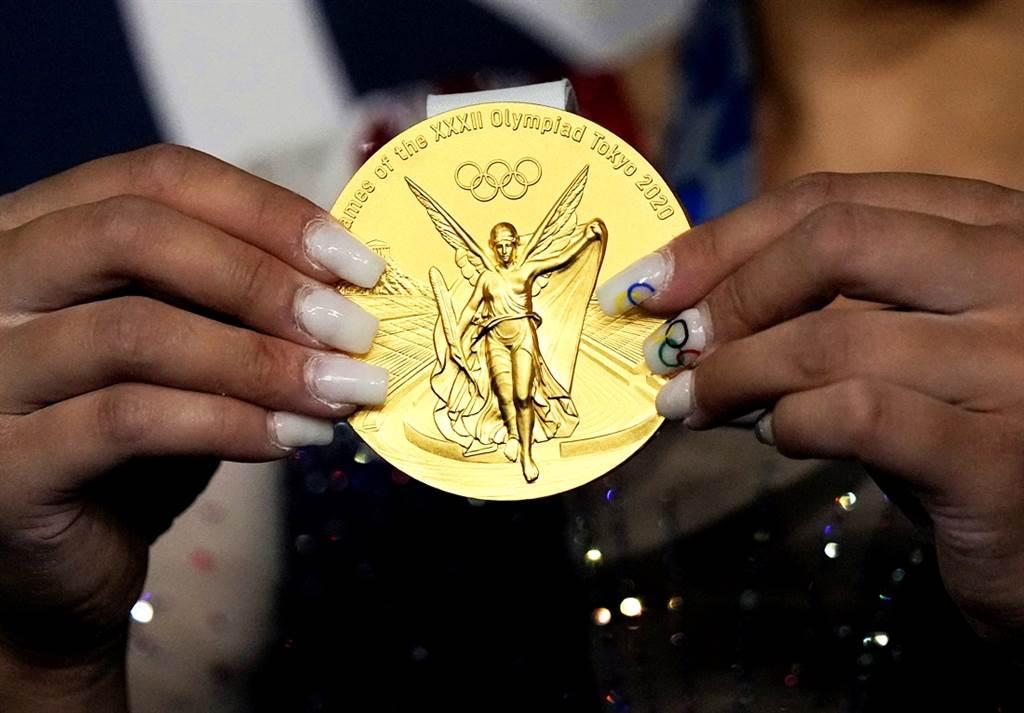 部份奧運金牌得主後續賣掉獎牌,專家指出,得主賣獎牌,背後原因通常很「悲慘」,除了生活不濟外,還有人必須接受心理治療。(資料照/美聯社)