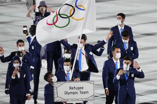 從2016年里約奧運開始出現了「難民代表隊」,由各個動亂國家的難民組成,代表全球8200萬流難失所的難民。本屆東奧難民代隊有29名運動員,分別來自11個國家。(圖/美聯社)