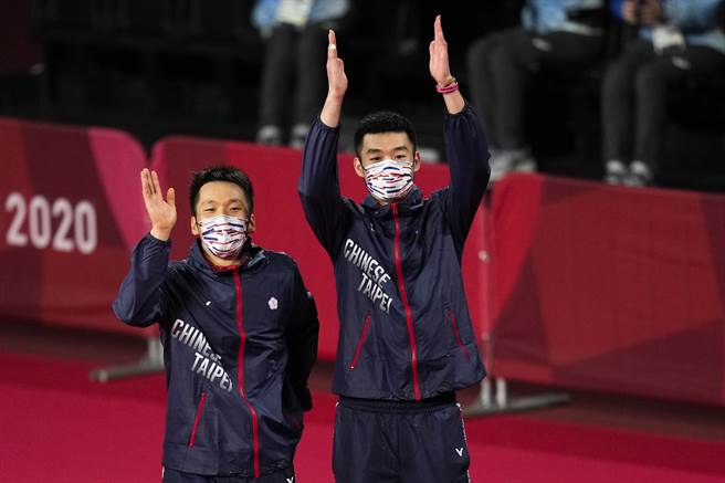 中華隊終於奧運拿到羽球獎牌,李洋(左)、王齊麟(右)更摘下史上首金。(資料照/美聯社)