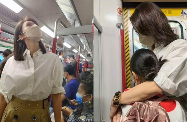 黎姿在車廂內抱著女兒。(圖/翻攝自黎姿微博)